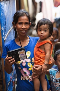 Christian radio still reaches people like this mother from the Philippines who don't have access to other forms of broadcast. Each year, FEBC distributes thousands of preset radios airing Gospel music, Christian teaching, biblical encouragement, and health advice.